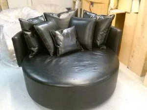 All in black leather rounded Chaise